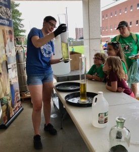 Katherine making elephant toothpaste for the Girl Scouts